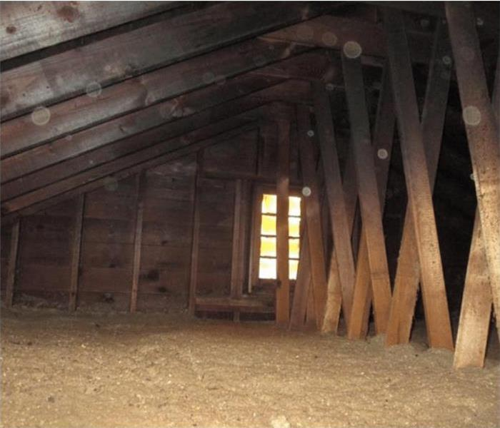 Rafters in an Attic covered in Soot from a fire