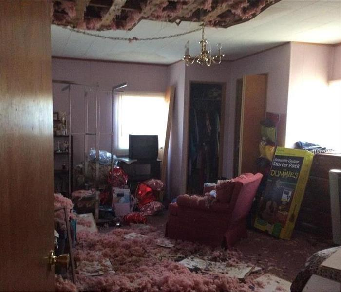 Room filled with falling insulation and ceiling caving in