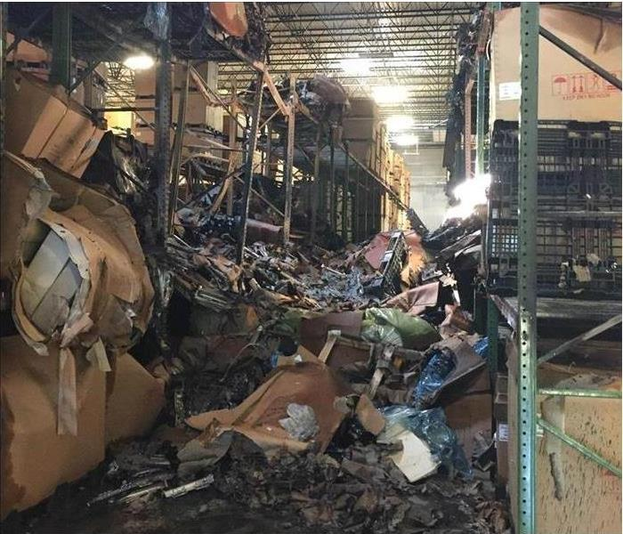 Warehouse or Storage area of business with piles of burned debris/contents