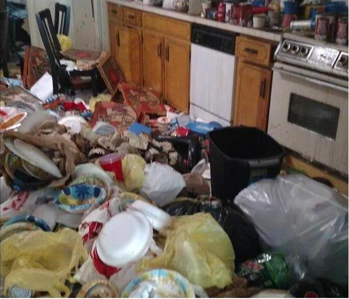 Kitchen Floor covered in garbage