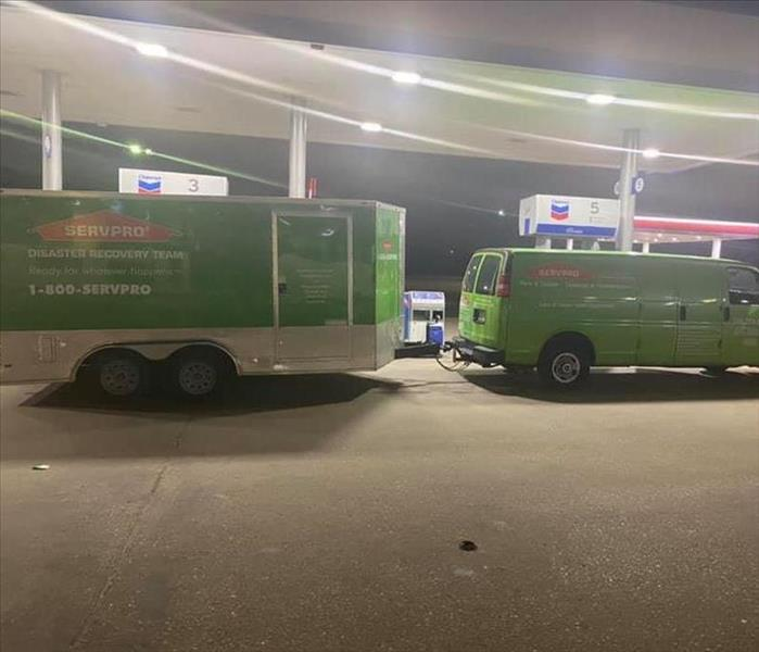 Van and Trailer at gas station